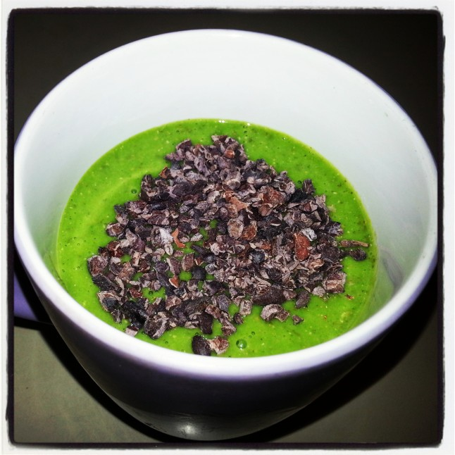 I'm beginning to love drinking a green smoothie for breakfast!  I like to top it with a sprinkle of raw cacao nibs.  Yum!! :)