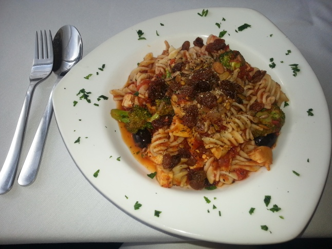 "Mediterranean Pasta: ""Brocolli, sunflower & pumpkin seeds, raisins, tomatoes & olives in a light tomato olive oil sauce."""