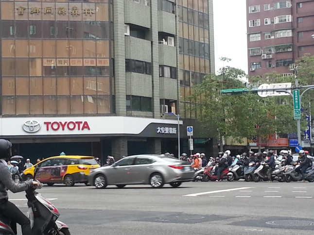 It seems like there are more motorcycles on the road than cars. Usually I see only motorcycles at the front behind the traffic lights; cars are behind.