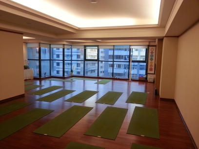 The spacious sunny yoga studio room
